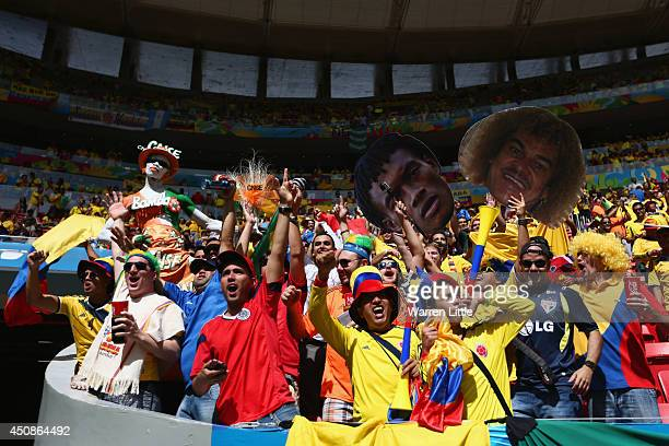 Fans cheer prior to the 2014 FIFA World Cup Brazil Group C match between Colombia and Cote D'Ivoire at Estadio Nacional on June 19 2014 in Brasilia...