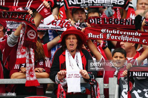 Fans cheer prior to the Bundesliga match between 1 FC Nuernberg and Borussia Dortmund at Easy Credit Stadium on September 1 2012 in Nuremberg Germany