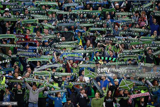 Fans cheer prior to the match between the Seattle Sounders FC against the New England Revolution at CenturyLink Field on March 8 2015 in Seattle...