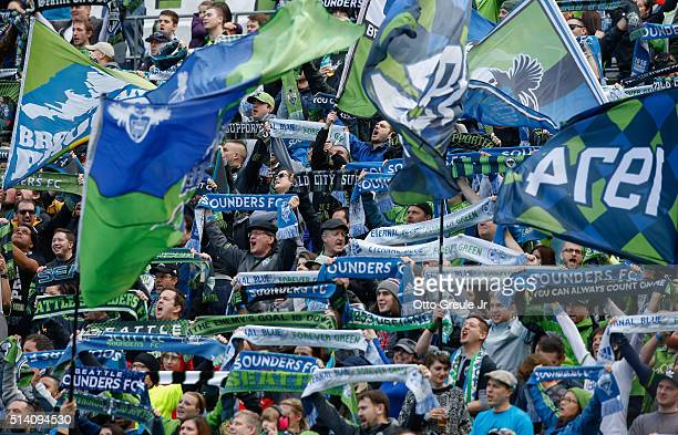 Fans cheer prior to the match between the Seattle Sounders FC and Sporting Kansas City at CenturyLink Field on March 6 2016 in Seattle Washington...