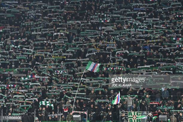 Fans cheer prior to the UEFA Europa League round of 32 firstleg football match between Rapid Wien and Inter Milan in Vienna on February 14 2019