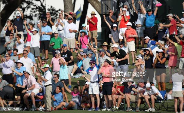 Fans cheer Sergio Garcia's holeinone on the 17 island green during the first round of THE PLAYERS Championship on THE PLAYERS Stadium Course at TPC...