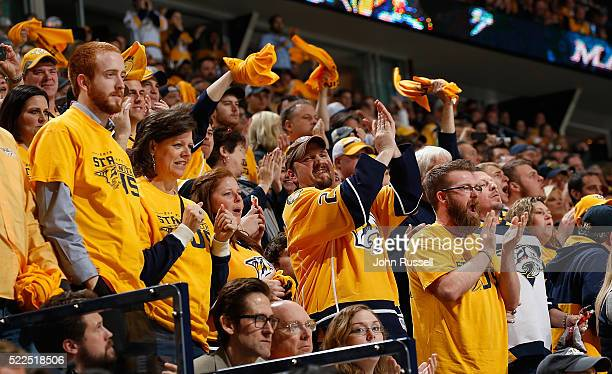 Fans cheer the Nashville Predators in Game Three of the Western Conference First Round against the Anaheim Ducks during the 2016 NHL Stanley Cup...