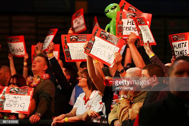 Fans cheer the players during the Whyte Mackay Premier League Darts at NIA Arena on March 26 2009 in Birmingham England