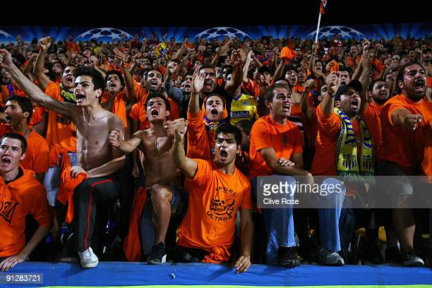 APOEL fans cheer their team on during the UEFA Champions League Group D match between Apoel Nicosia and Chelsea at the GSP Stadium on September 30...