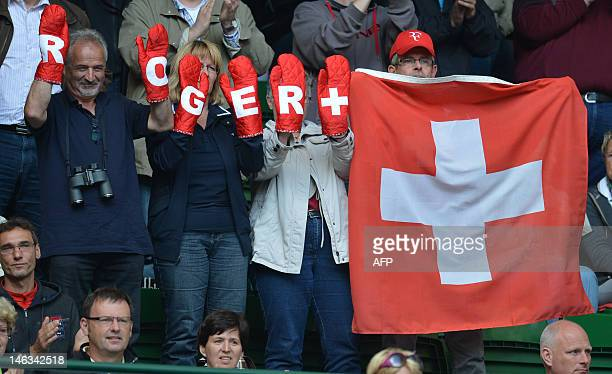 Fans cheer to Swiss player Roger Federer during his second round match against Germany's Florian Mayer at the ATP Gerry Weber Open tennis tournament...
