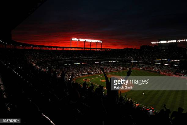 Fans cheer under a sunset as Pedro Alvarez of the Baltimore Orioles rounds the bases after hitting a two run home run against the New York Yankees...