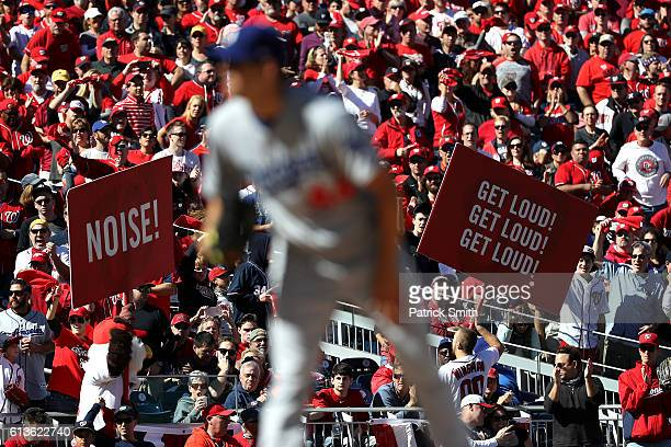 Fans cheer while Rich Hill of the Los Angeles Dodgers works against the Washington Nationals in the second inning during game two of the National...