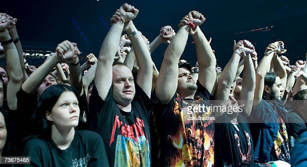 Fans cheer while the heavy metal band Manowar performs during a concert at the MaxSchmelingHalle March 22 2007 in Berlin Germany The concert is part...