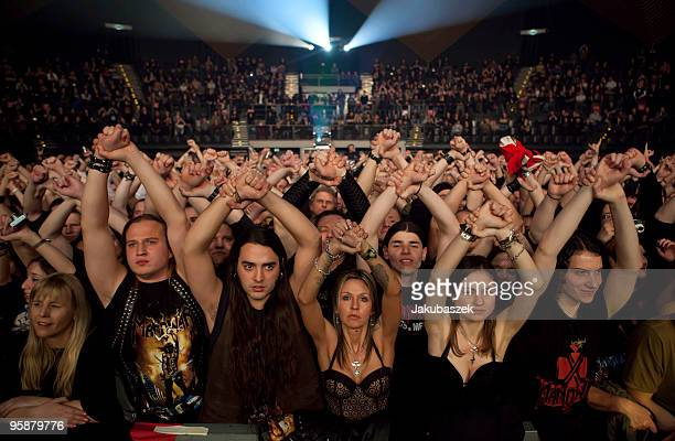 Fans cheer while the USAmerican metal band Manowar performs live during a concert at the Tempodrom on January 19 2010 in Berlin Germany The concert...