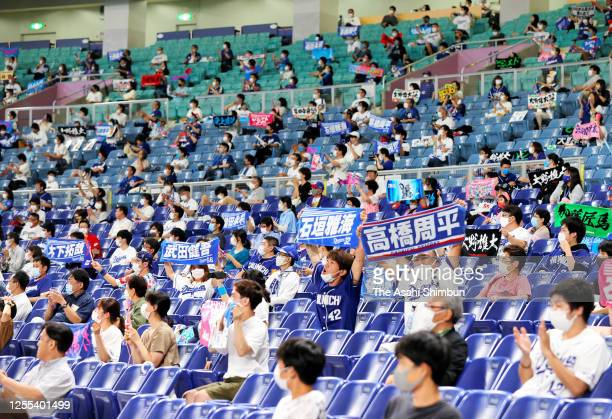 Fans cheer with keeping social distances during the game between Hiroshima Toyo Carp and Chunichi Dragons at the Nagoya Dome on July 10, 2020 in...