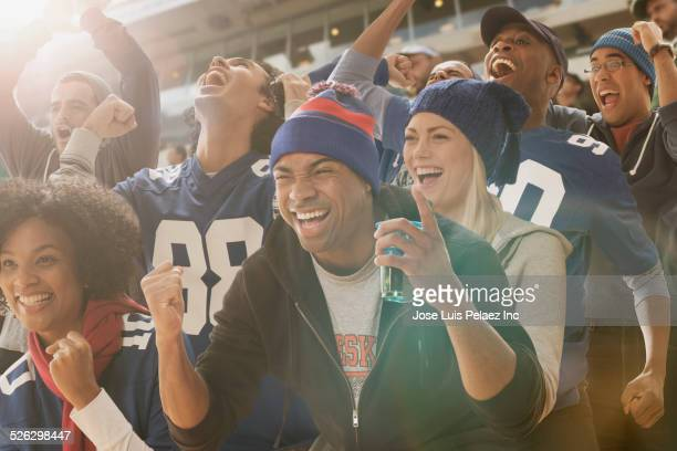 Fans cheering at American football game