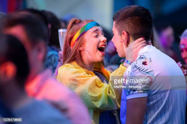 Fans cheering during the Pride Cymru Big Weekend on August 26 2018 in Cardiff Wales Pride Cymru aims to eliminate discrimination on the grounds of...