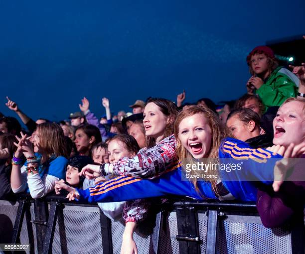 Fans cheering for Scouting For Girls performing on stage on the first day of Cornbury Festival on July 11 2009 near Charlbury United Kingdom