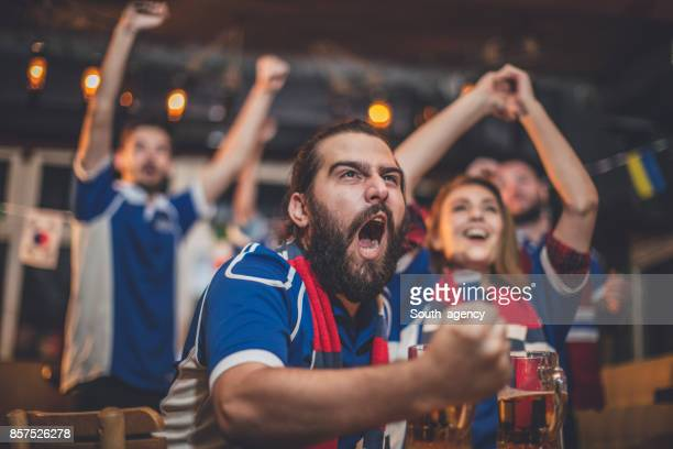 fans cheering for their team - sports jersey stock pictures, royalty-free photos & images