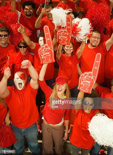fans cheering - foam finger stock photos and pictures