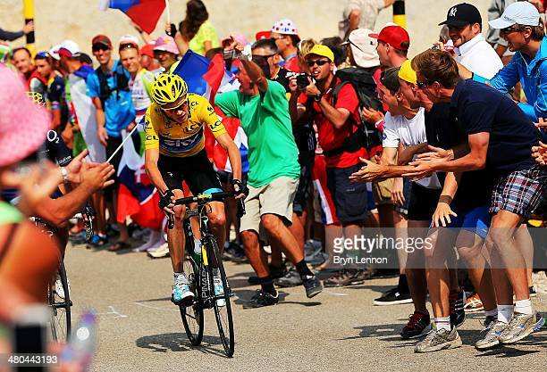 Fans cheers as current race leader and wearer of the Maillot Jaune Chris Froome of Great Britain and SKY Procycling attacks to win the stage during...