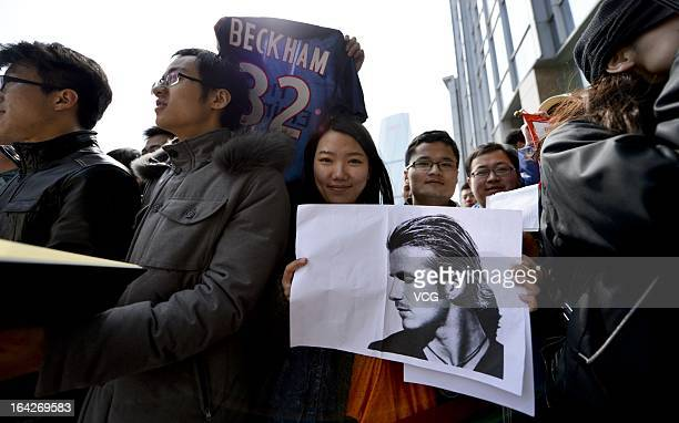 Fans cheers as David Beckham arrives at hotel on March 22 2013 in Qingdao Shandong Province of China