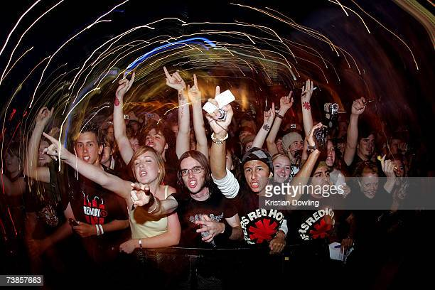 Fans cheers as members of the Red Hot Chili Peppers perform during a concert at Federation Square on April 11 2007 in Melbourne Australia