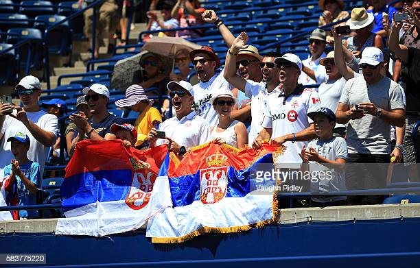 Fans cheers for Novak Djokovic of Serbia in his match against Gilles Muller of Luxembourg on Day 3 of the Rogers Cup at the Aviva Centre on July 27...
