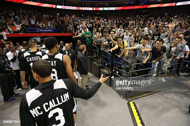 Fans cheers for the Sacramento Kings laughs during Fan Appreciation Day as part of 2014 Global Games on October 10 2014 at the MercedesBenz Arena in...