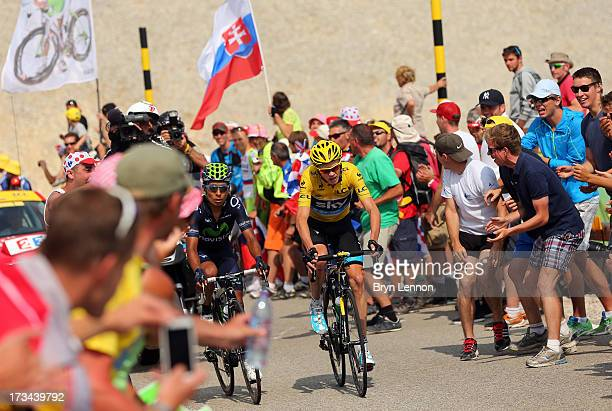 Fans cheers Nairo Quintana of Colombia and Movistar Team and Chris Froome of Great Britain and SKY Procycling as they attack during stage fifteen of...