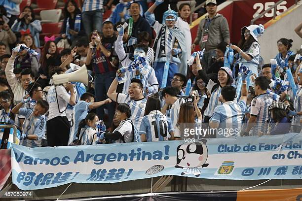Fans cheers up for Argentina during a match between Argentina and Brazil as part of 2014 Super Clasico at Beijing National Stadium on October 11 2014...