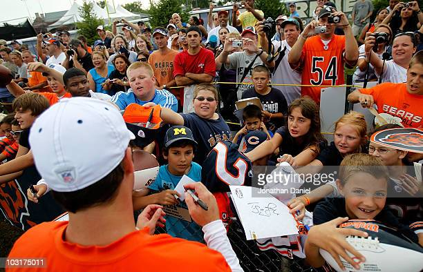 Fans clamor for an autograph from Jay Cutler of the Chicago Bears after a summer training camp practice at Olivet Nazarene University on July 30 2010...