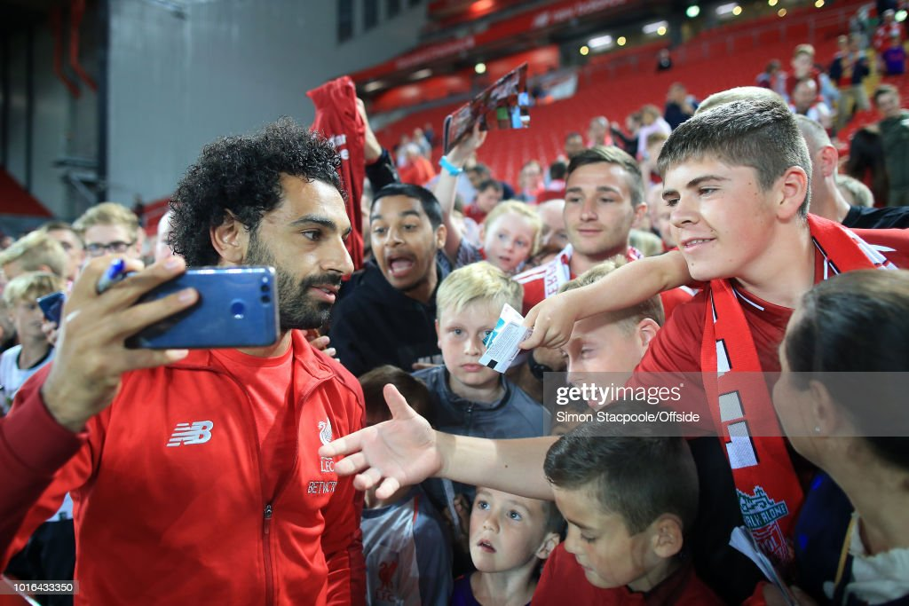 Fans clamour to get a selfie with Mohamed Salah of Liverpool after the pre-season friendly match between Liverpool and Torino at Anfield on August 7, 2018 in Liverpool, England.