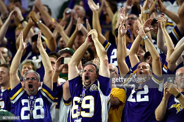 Fans clap in unison during a 'Viking Chant' before the Minnesota Vikings play against the Green Bay Packers in the first regular season game at US...