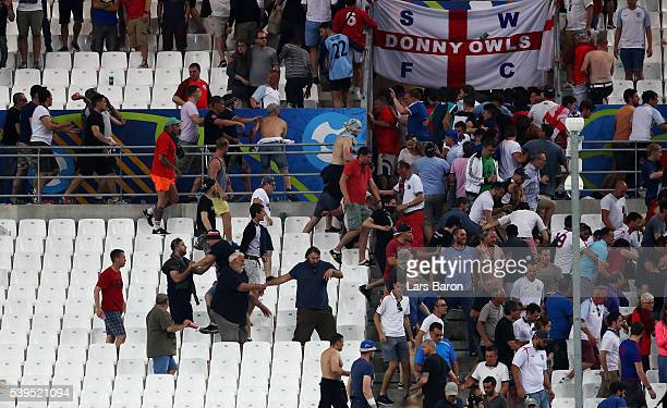 Fans clash after the UEFA EURO 2016 Group B match between England and Russia at Stade Velodrome on June 11 2016 in Marseille France
