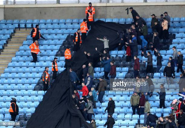 Fans clash during the The Emirates FA Cup Third Round match between Coventry City and Stoke City at Ricoh Arena on January 6 2018 in Coventry England