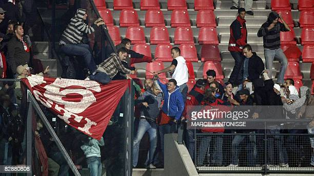 NEC fans clash with Dinamo Boekarest fans in the tribunes after the UEFA Cup first round football match between NEC and Dinamo Boekarest in Nijmegen...
