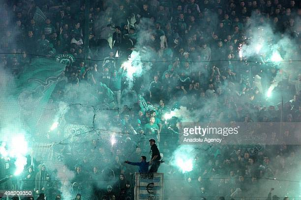 Fans clash with riot police on the pitch before the Greek Super League football match between Panathinaikos Athens and Olympiakos Piraeus in Athens,...
