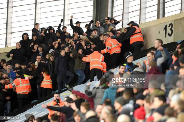 Fans clash with stewards during the The Emirates FA Cup Third Round match between Coventry City and Stoke City at Ricoh Arena on January 6 2018 in...