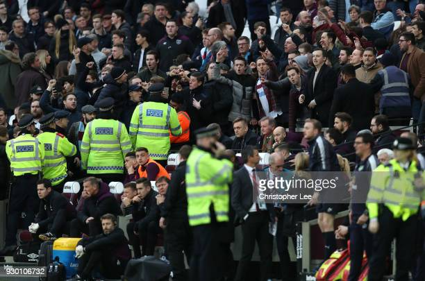 Fans clash with the police during the Premier League match between West Ham United and Burnley at London Stadium on March 10 2018 in London England