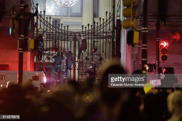 Fans climb City Hall fence while celebrating in Center City after the Philadelphia Eagles defeated the New England Patriots to win the Super Bowl on...