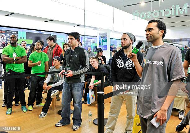 Fans compete in a gaming tournament at the Microsoft retail store at the Burlington Mall in Burlington Massachusetts on November 21 2013 Microsoft...