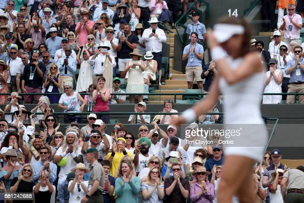 Fans congratulate Johanna Konta of Great Britain as she celebrates after her victory against Caroline Garcia of France in the Ladies' Singles round...