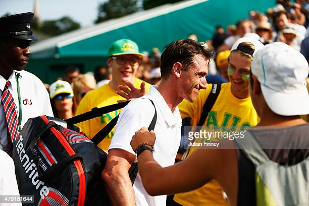 Fans console John Millman of Australia after defeat in his Gentlemens Singles Second Round match against Marcos Baghdatis of Cyprus during day three...