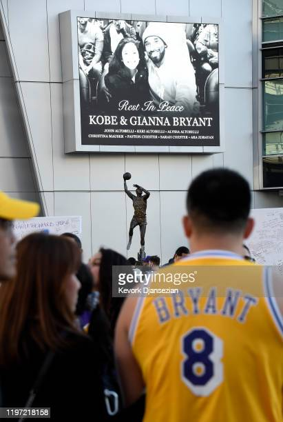 Fans continue to pay their respects to Kobe Bryant and his daughter Gianna at a memorial set up near Kareem Abdul Jabbar statue outside of Staples...