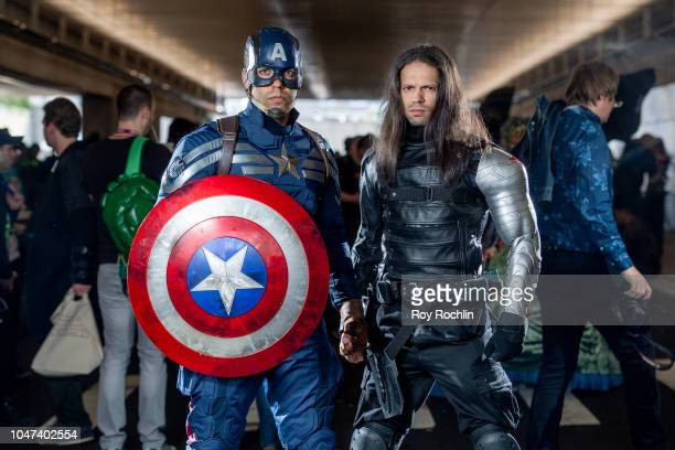 Fans cosplay as Bucky Barnes and Captain America from the Marvel Universe during the 2018 New York Comic-Con at Javits Center on October 7, 2018 in...