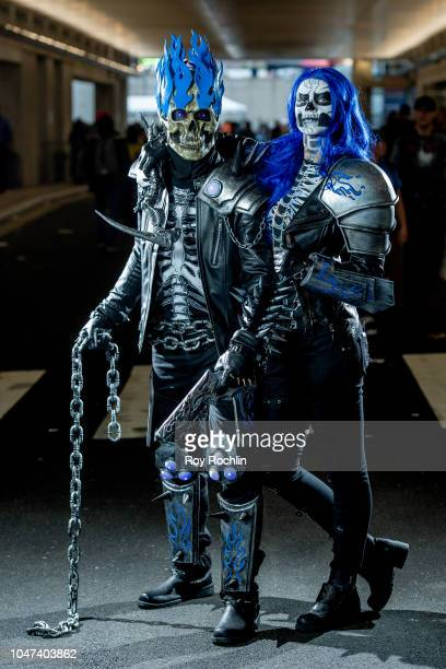 Fans cosplay as Ghost Rider and Wife form the DC Universe during the 2018 New York ComicCon at Javits Center on October 7 2018 in New York City