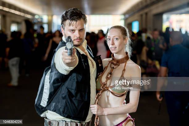 Fans cosplay as Han Solo and Princess Leia form Star Wars during the 2018 New York Comic Con at Javits Center on October 5, 2018 in New York City.