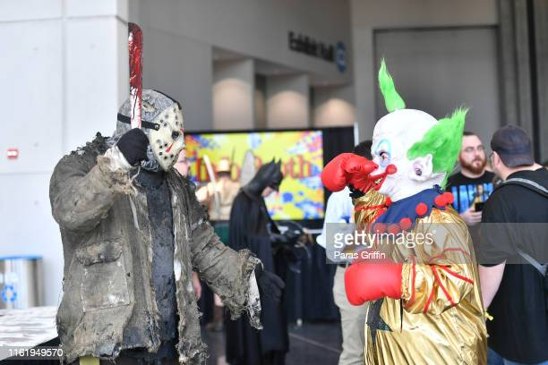Fans cosplay as Jason Voorhees and the clown during 2019 Atlanta Comic Con at Georgia World Congress Center on July 13 2019 in Atlanta Georgia