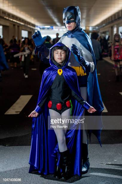 Fans cosplay as Raven from Teen Titans Go and Adam West Batman form the DC Universe during the 2018 New York ComicCon at Javits Center on October 7...