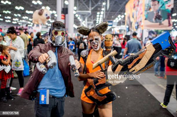 Fans cosplay as StarLord and Rocky Raccoon from Guardians of the Galaxy during the 2017 New York Comic Con Day 4 on October 8 2017 in New York City
