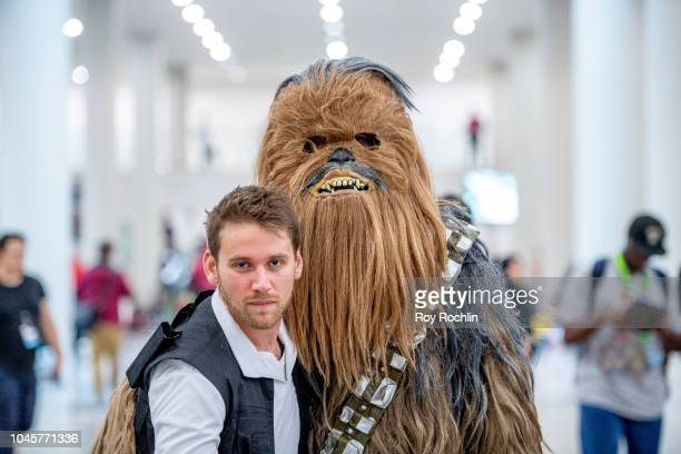 Fans cosplays as Han Solo and Chewbacca from Star Wars during the 2018 New York Comic Con at Javits Center on October 4, 2018 in New York City.