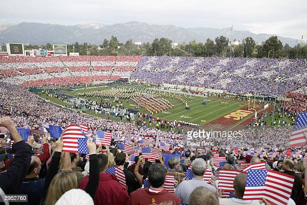 Fans create a American flag using colored placards during the pregame ceremony for the 2004 Rose Bowl game between the USC Trojans and Michigan...