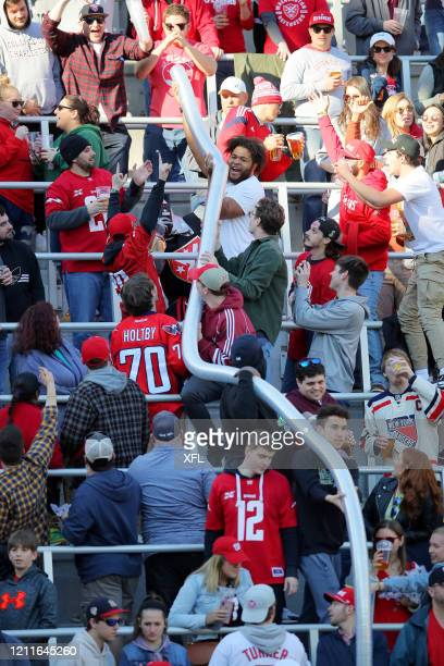 Fans create a 'beer snake' during the XFL game between the St. Louis BattleHawks and the DC Defenders at Audi Field on March 8, 2020 in Washington,...